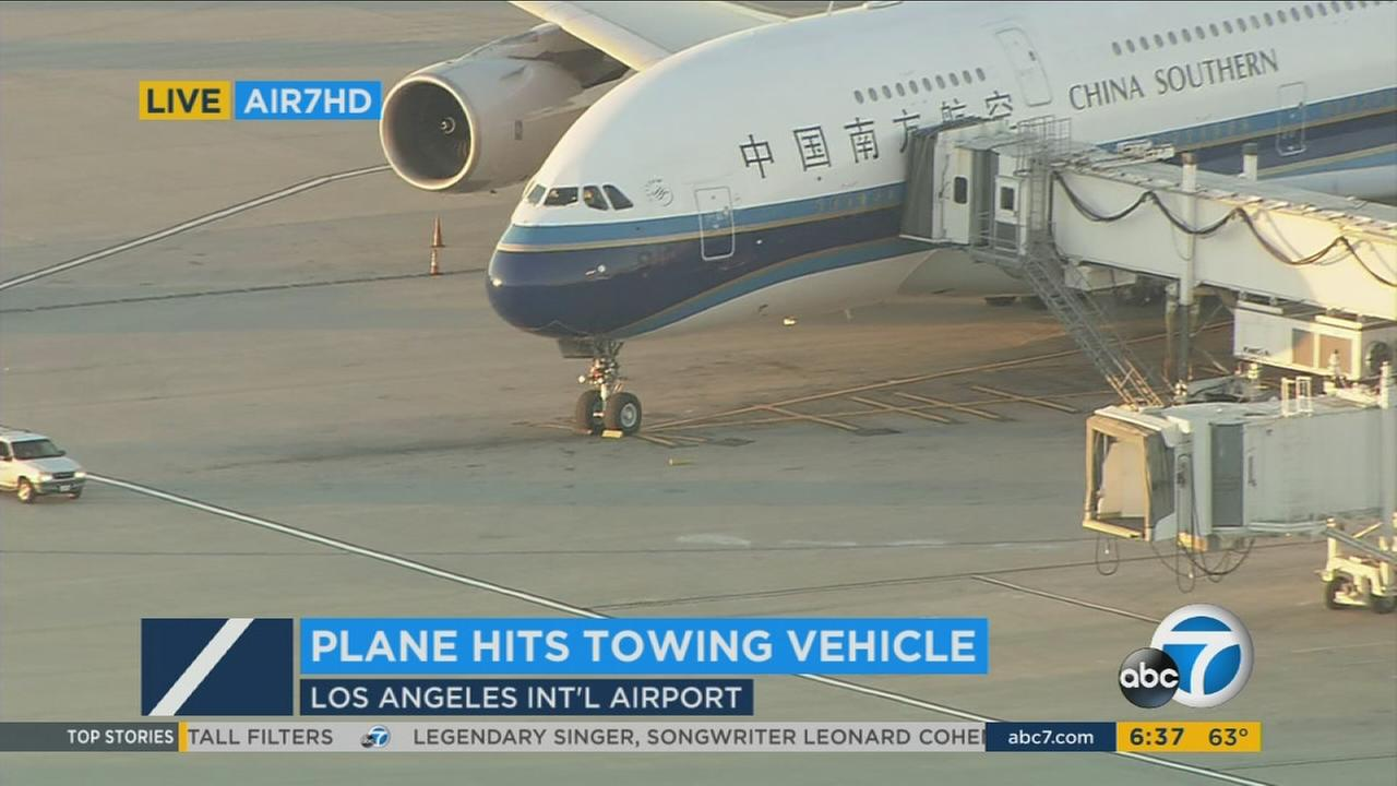 China Southern Airlines plane sits at Los Angeles International Airport after it collided with a tug vehicle on Friday, Nov. 11, 2016.