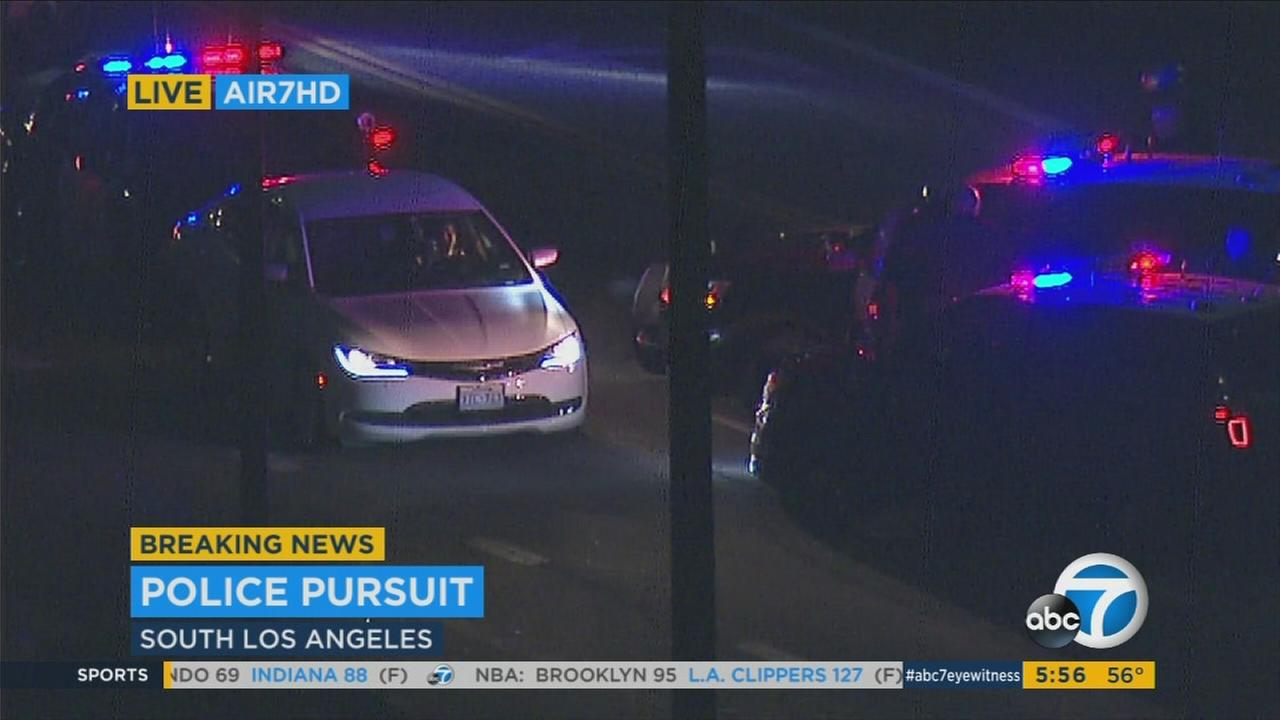 California Highway Patrol vehicles surrounded a car at the end of a pursuit in South Los Angeles on Tuesday, Nov. 15, 2016.