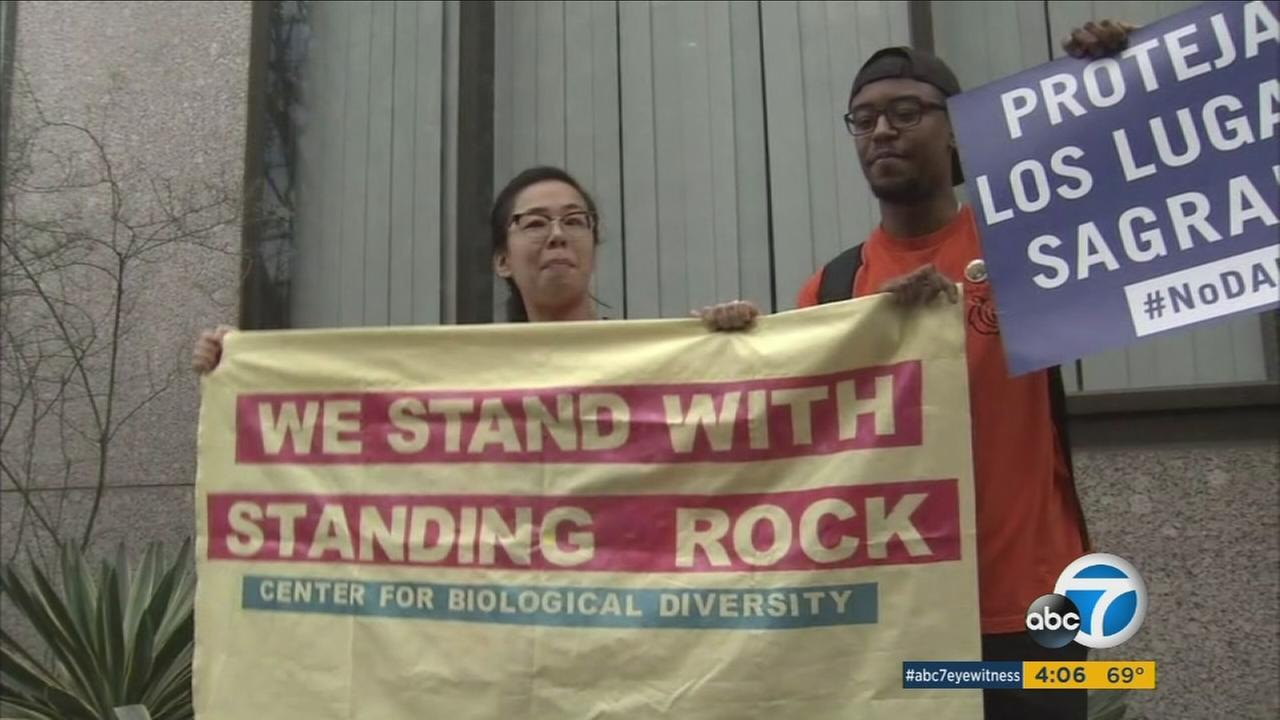Protests were held in Los Angeles and across the nation Tuesday over the Dakota Access Pipeline project, which has drawn opposition from Native American groups who say it threatens their sacred land and drinking water supply.