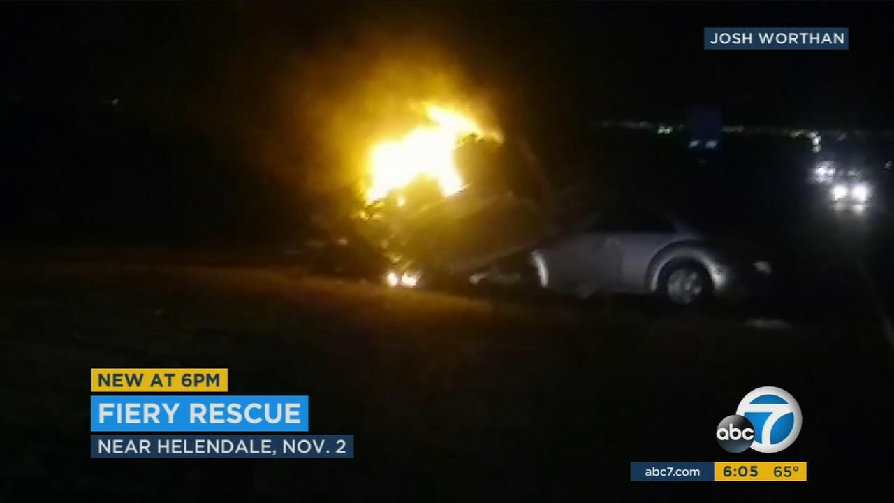 One driver was left trapped in his vehicle amid flames after a Hyundai slammed head-on from the opposite side of the road.