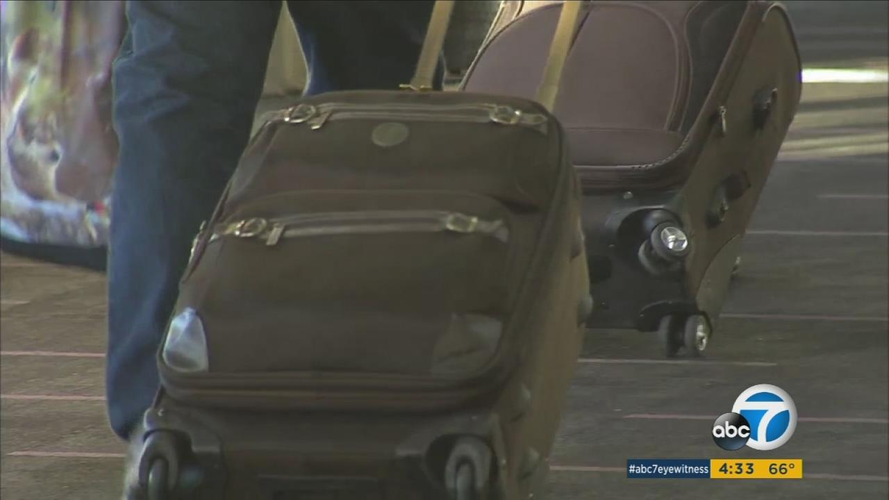 People drag their luggage through Los Angeles International Airport during the holiday season.