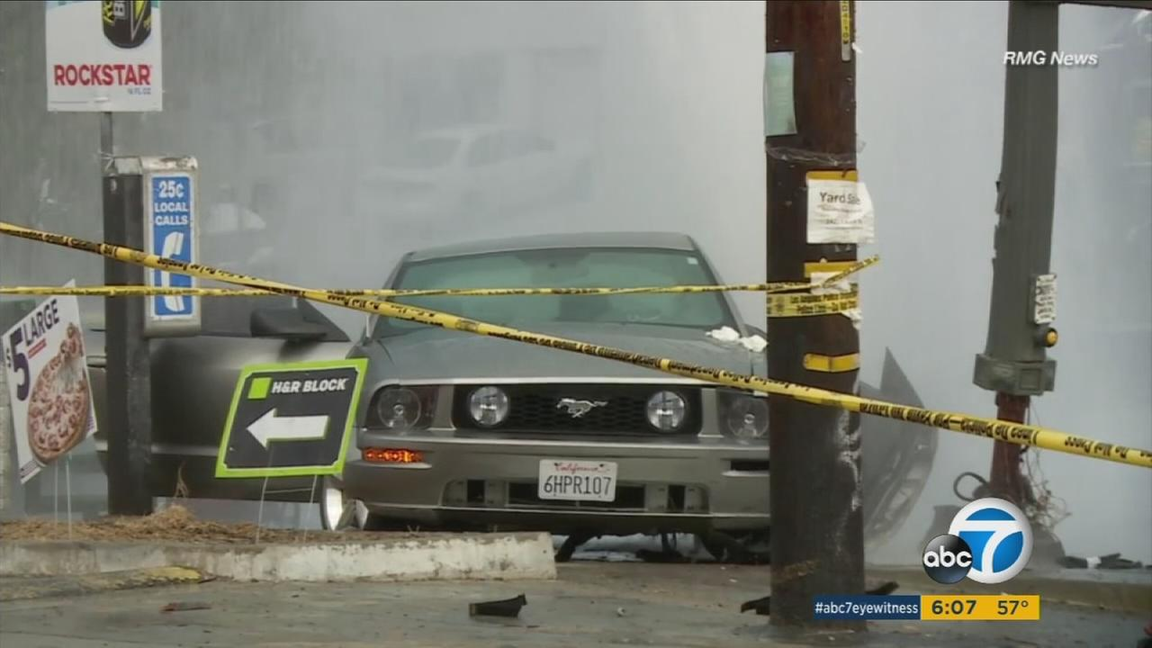 Two women standing at a bus stop in Echo Park were killed by a car that jumped a curb, struck a street light and a fire hydrant on Sunday, Nov. 20, 2016, according to officials.