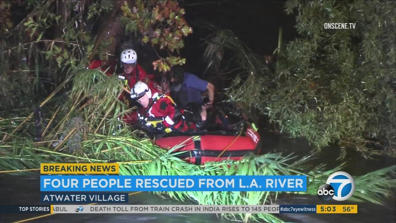 Firefighters rescued four stranded people from the Los Angeles River in Atwater Village on Monday, Nov. 21, 2016.