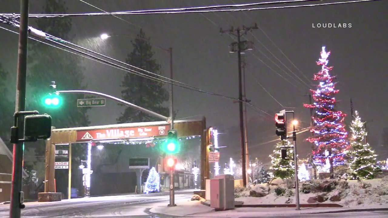 Buildings in Big Bear Lake are seen covered in snow following a storm.