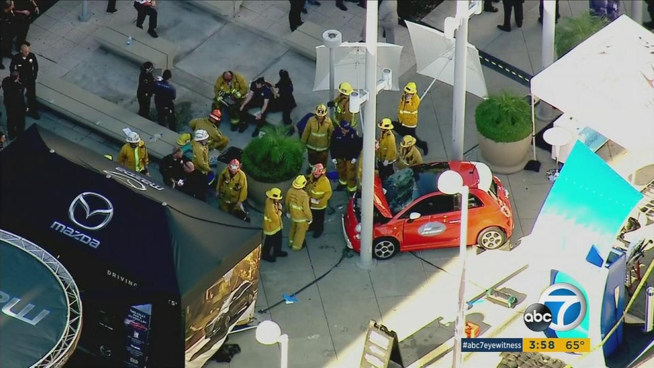 A Fiat 500 partially mangled after it struck pedestrians in downtown Los Angeles on Monday, Nov. 21, 2016.