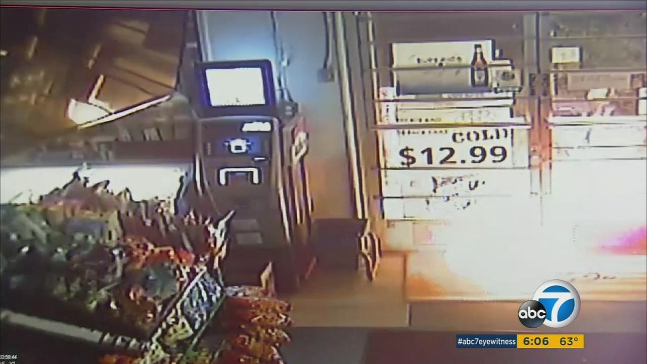 Surveillance video from a Riverside liquor store shows the moments when a suspect set fire to the business on Nov. 11, 2016.