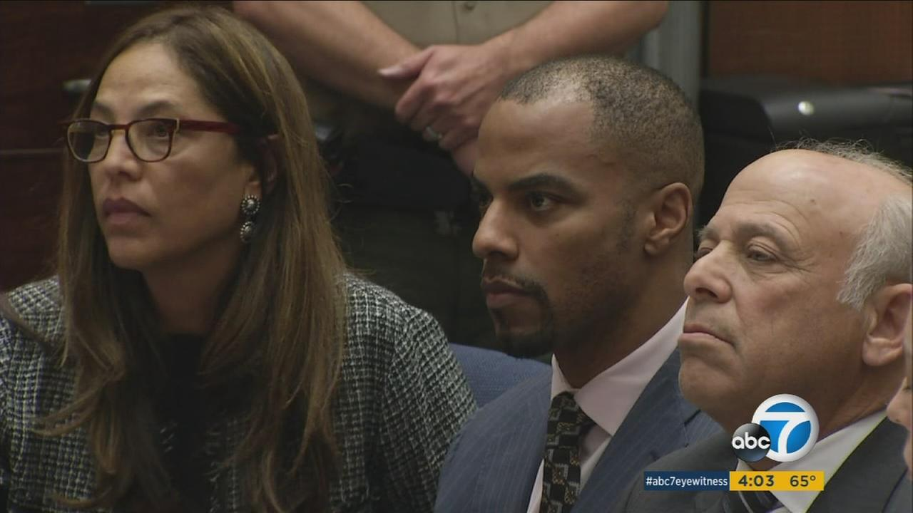 Former NFL safety Darren Sharper, center, is flanked by his attorneys, Lisa Wayne, left, and Leonard Levine, right, in Los Angeles Superior Court.