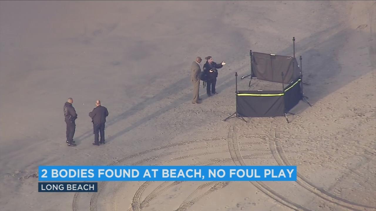 Authorities looked over the scene after a man was found dead in Long Beach and a woman was found in the SUV nearby on Monday, Dec. 5, 2016.