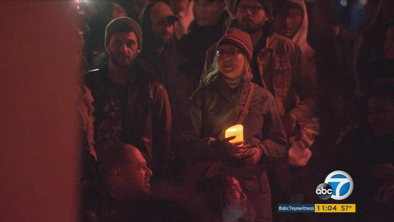 People gathered at a park in Oakland to hold a candlelight vigil for those lost in the Ghost Ship warehouse fire.