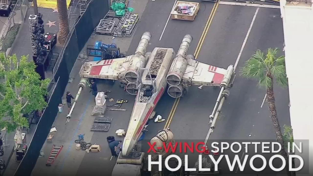 An X-Wing Starfighter landed on Hollywood Boulevard ahead of the premiere for Rogue One: A Star Wars Story.