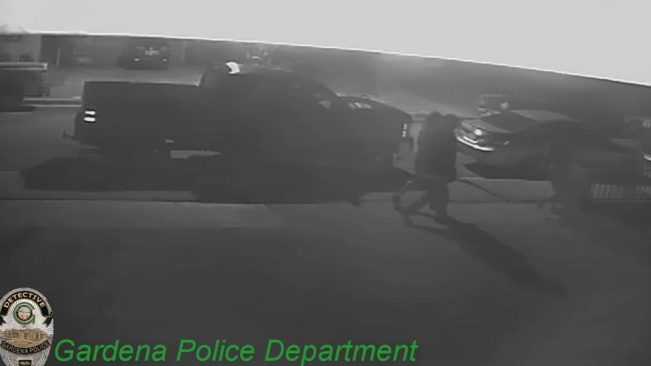 In this surveillance video released by Gardena police, murder victim Andy Portillo is seen walking home with two women as another man on foot and a slow-moving SUV follow them.