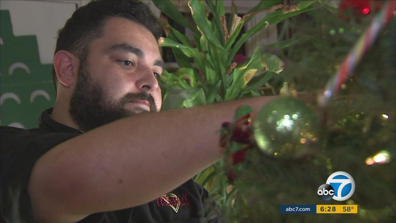 Omar Bataineh of Synergy Home Care stepped up to help decorate the home of an elderly couple in Los Angeles for the holidays.