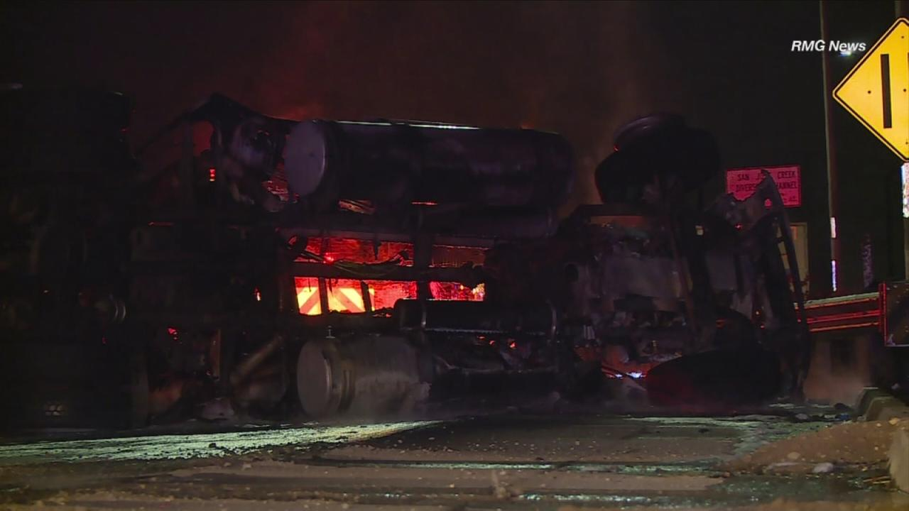 A semi-truck cabin erupted in flames after the driver - suspected of driving under the influence - crashed it on the northbound 605 Freeway in Bassett on Thursday, Dec. 8, 2016.