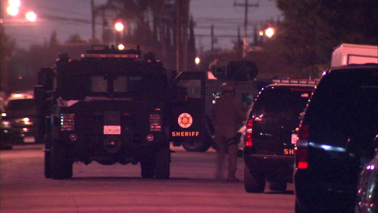 An hourslong standoff continued Friday morning at a home in Bellflower, involving a SWAT team and an armed man who was possibly mentally ill, authorities said.