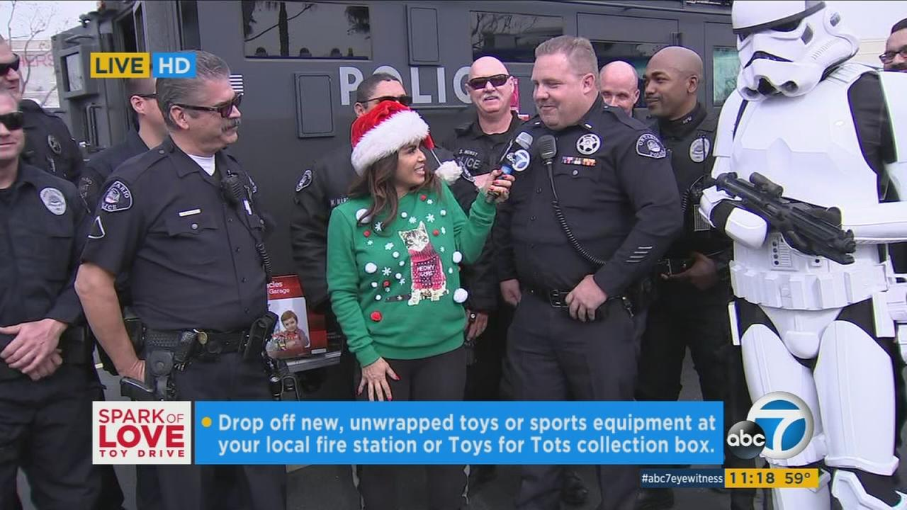 ABC7s Alysha Del Valle speaks with law enforcement at the annual Spark of Love toy drive on Friday, Dec. 9, 2016.
