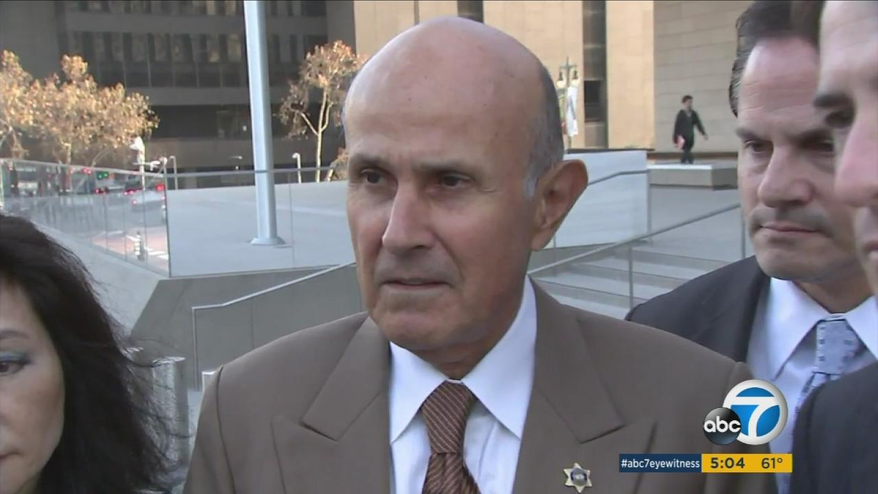 Former Los Angeles County Sheriff Lee Baca is shown heading into his third day of court for his corruption trial on Friday, Dec. 9, 2016.