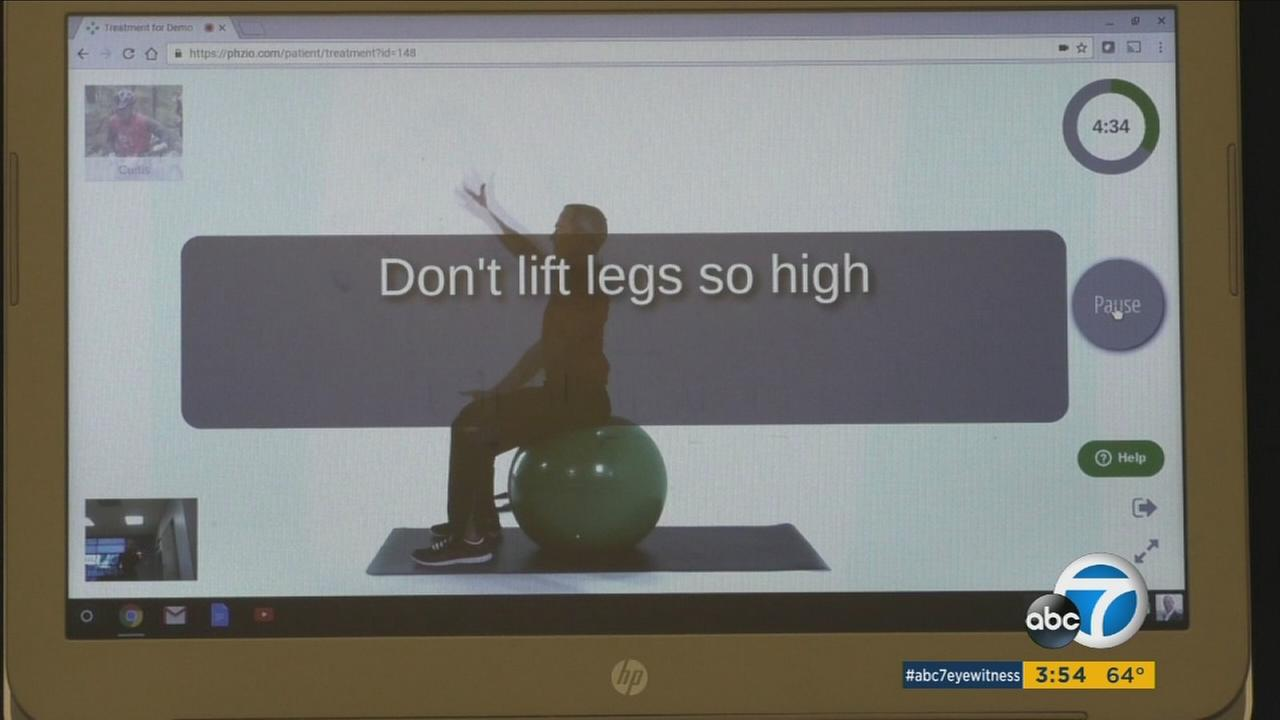 A screen shows a workout routine on a television that physical therapy clients can watch at home.