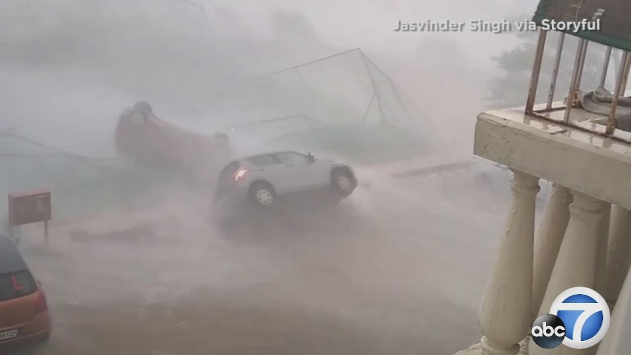 Cyclone Vardah toppled cars as it swept through India on Monday, Dec. 12, 2016.