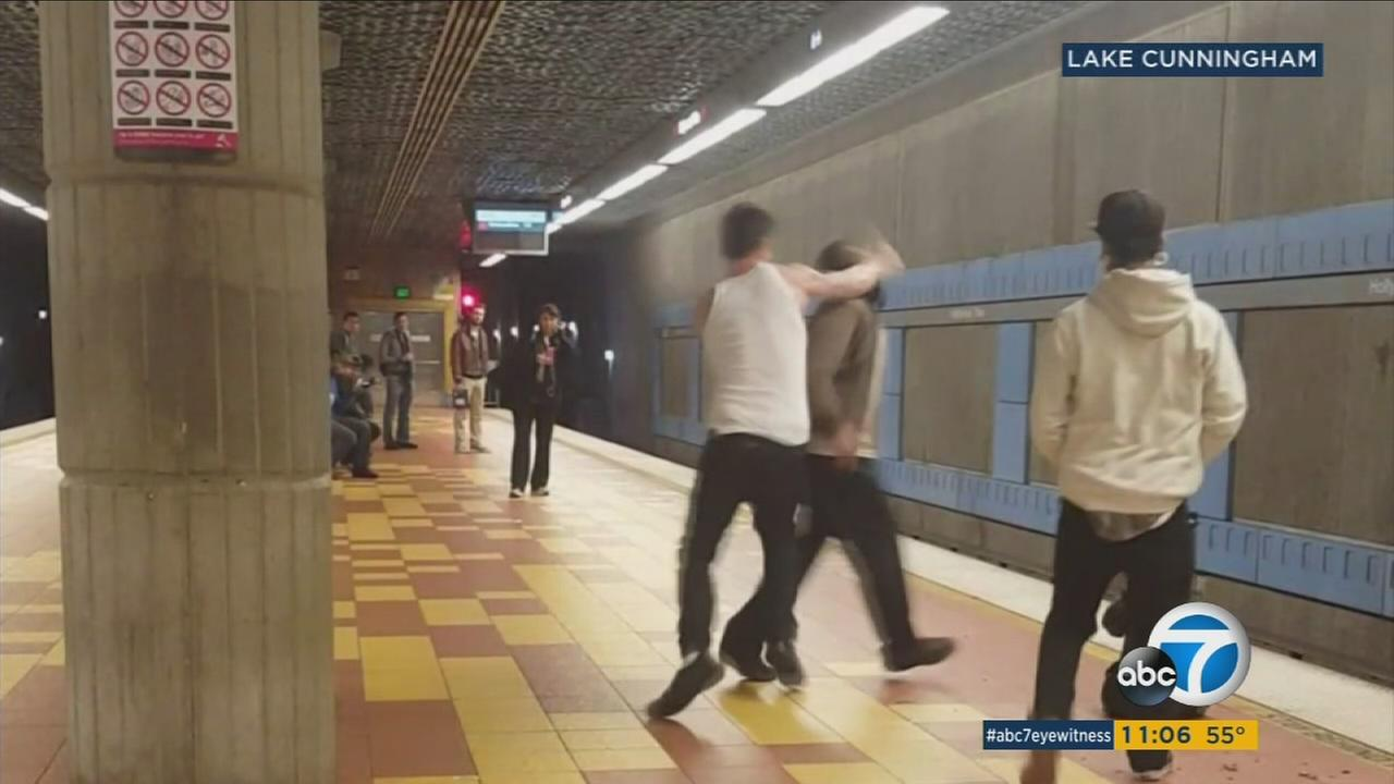 A man is seen being attacked by two suspects at a Metro station in Hollywood on Tuesday, Dec. 13, 2016.