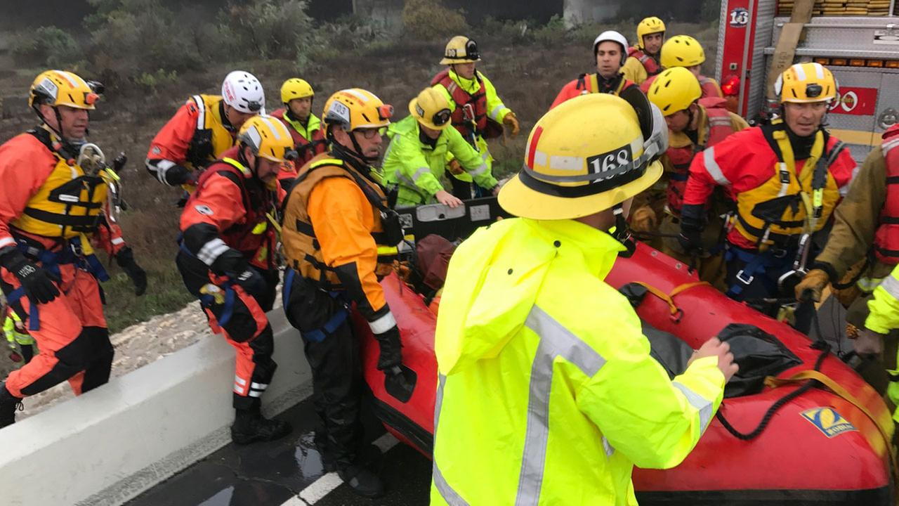 Fire crews rescued two women, a dog and a litter of puppies from an island in the San Gabriel River in South El Monte on Friday, Dec. 16, 2016.