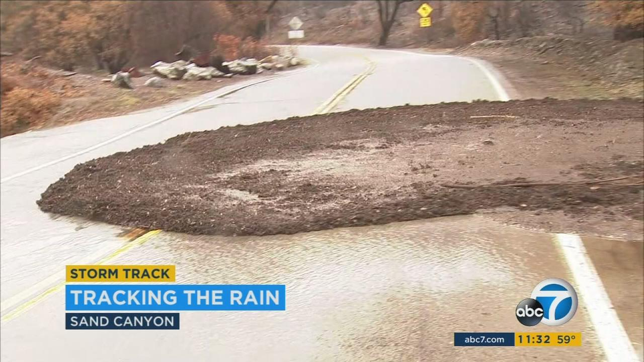 Heavy rain triggered a flash mudslide that smothered a roadway Friday morning in Santa Clarita, where officials had warned that such an incident was possible in the burn area of Julys massive Sand Fire.
