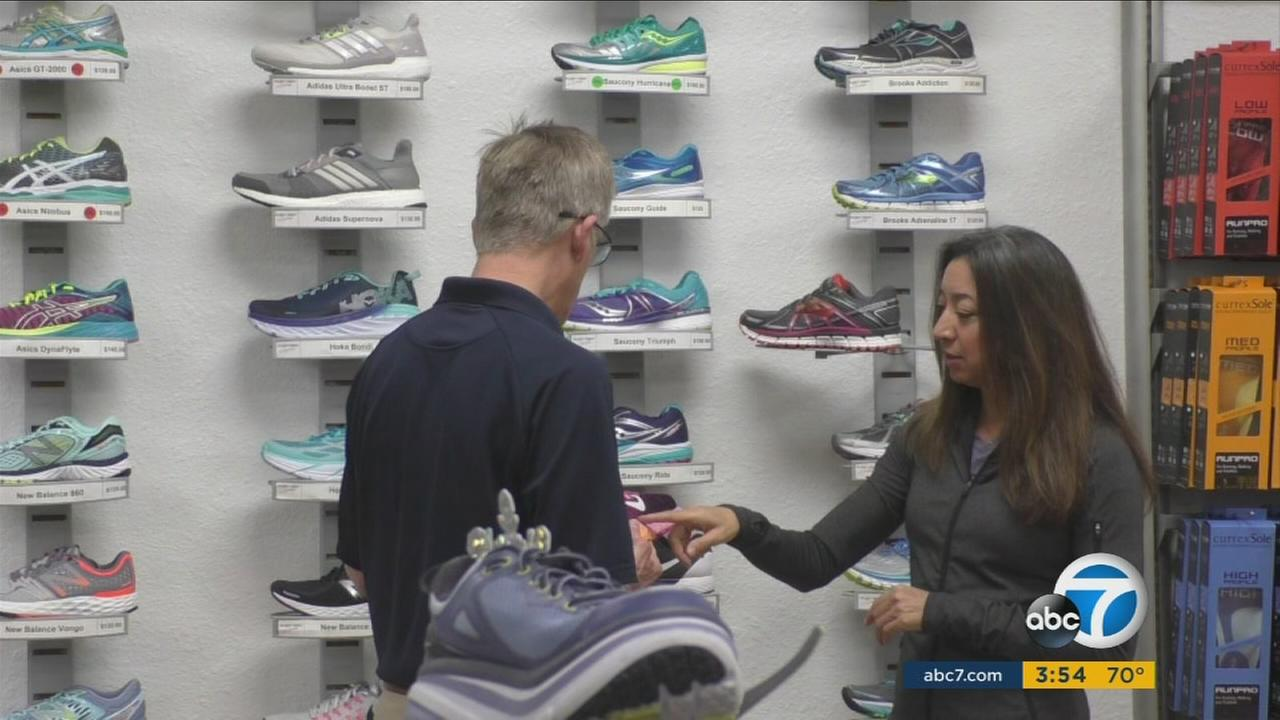 Runner Darcy Lang looks at athletic shoes at a store in this file photo.