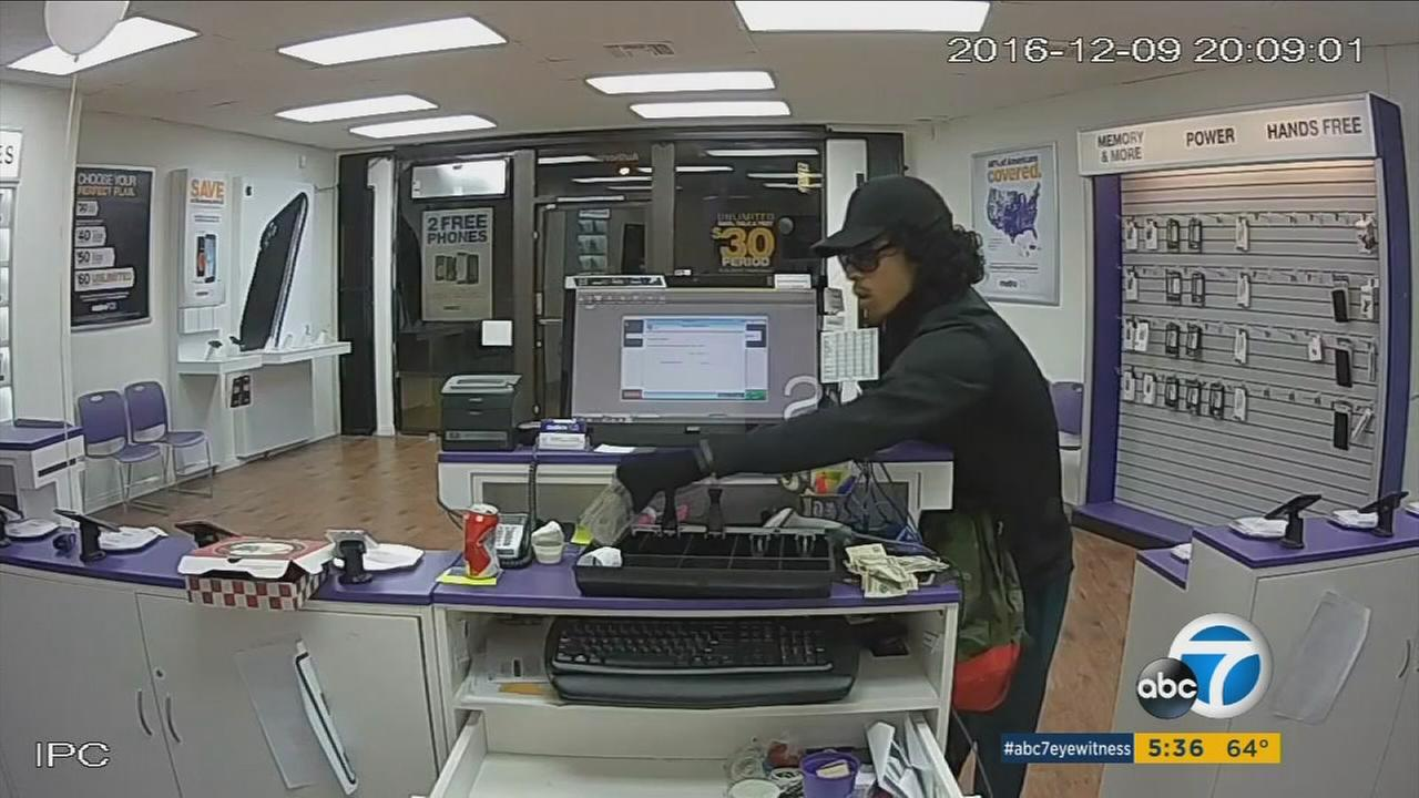 A robbery suspect wearing a wig is shown in surveillance footage from Dec. 9, 2016. He was identified as Dylan Watson, 22.