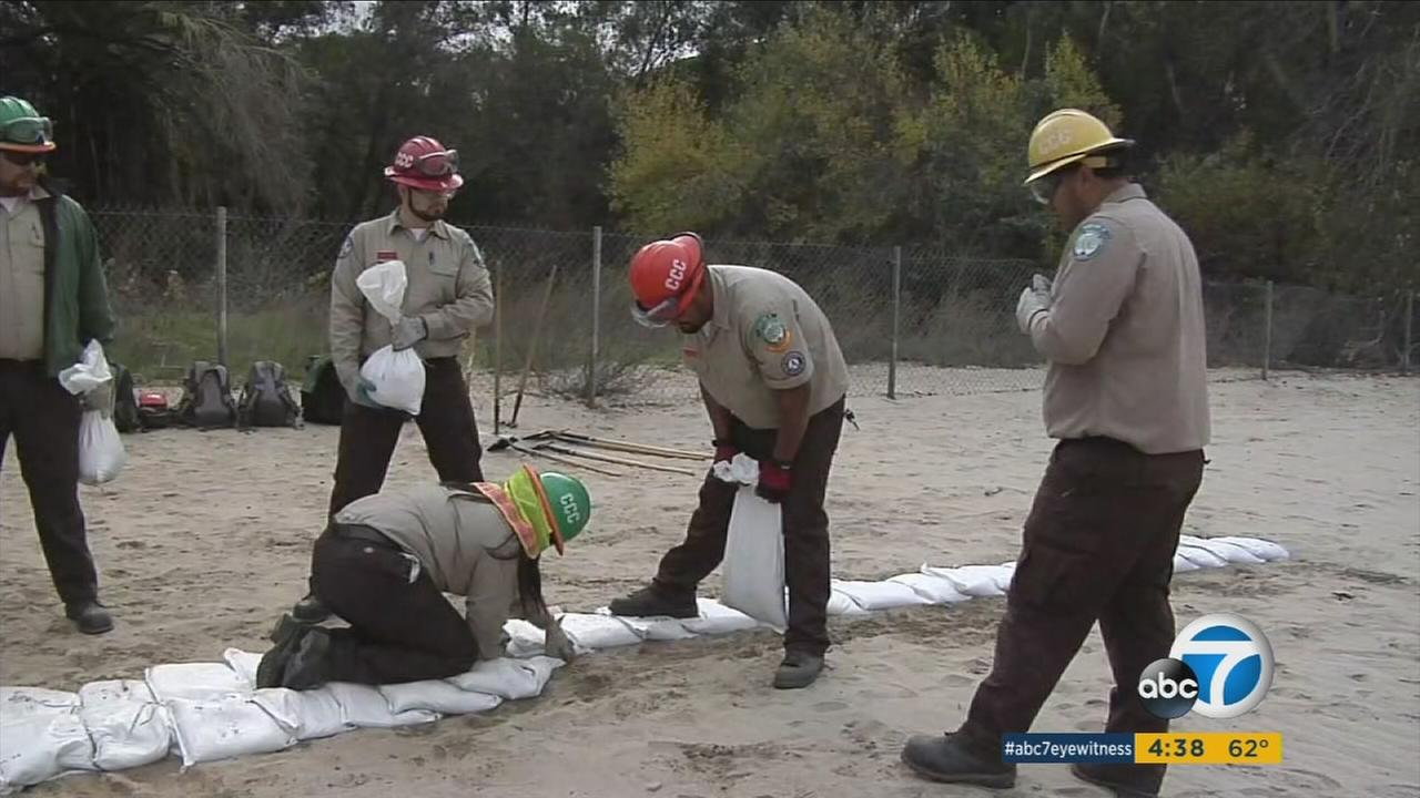 California Conservation Corps members train to prevent rainy-day problems in Riverside on Thursday, Dec. 22, 2016.