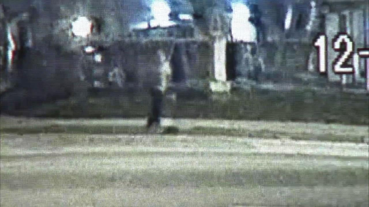 Surveillance video captures a man accused of starting fires before stealing from fire houses in Orange County.