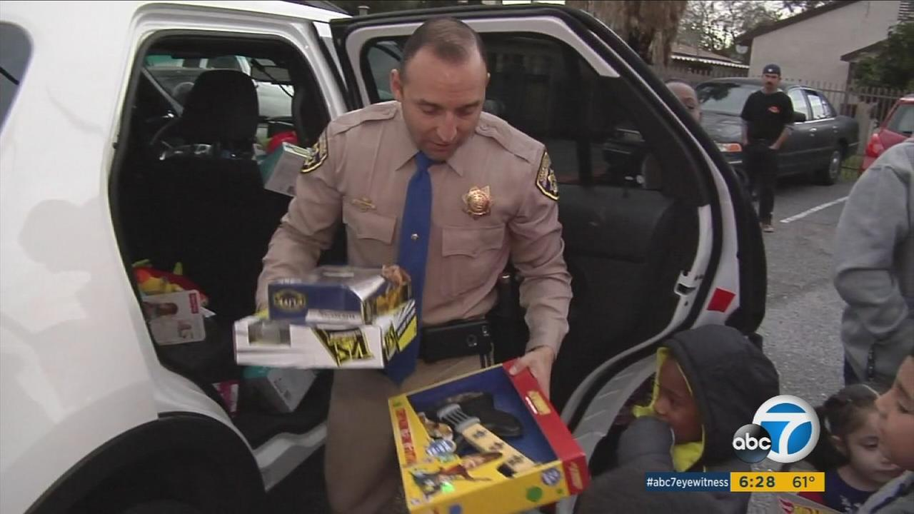 CHP officers brought some Christmas cheer - and a load of presents - to a young Riverside County girl who was struck by a hit-and-run driver.