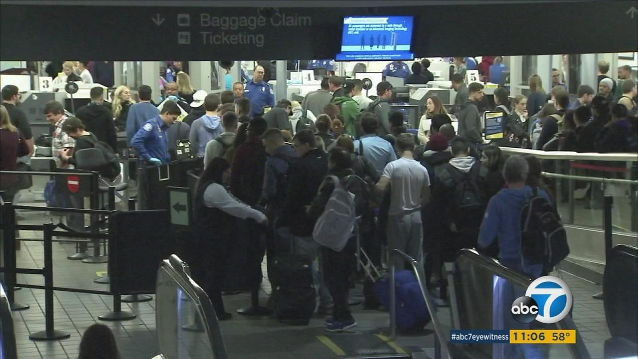 Long lines seen at Los Angeles International Airport during the pre-holiday rush on Thursday, Dec. 22, 2016.