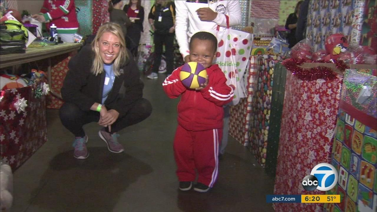 About 2,000 kids were given Christmas presents at downtown LAs Midnight Mission.