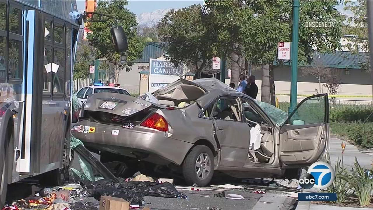 A car is mangled after it collided with a bus in Anaheim on Monday, Dec. 27, 2016.