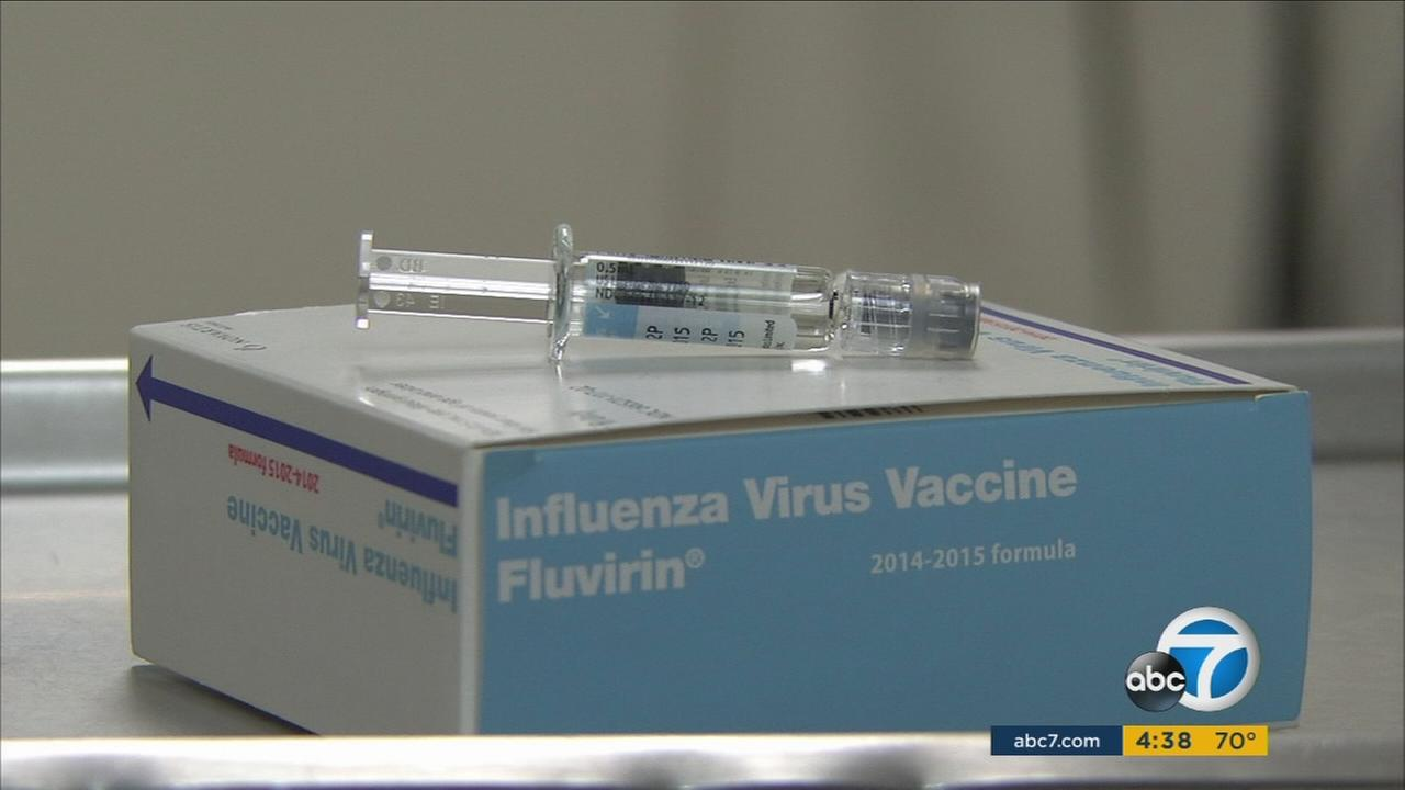 A vial containing a vaccine against influenza is seen in an undated file photo.