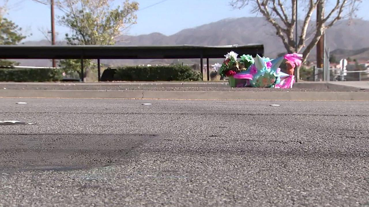 A memorial is set up for a homeless girl, 17, who was killed in a hit-and-run crash in Canyon Country on Monday, Dec. 26, 2016.