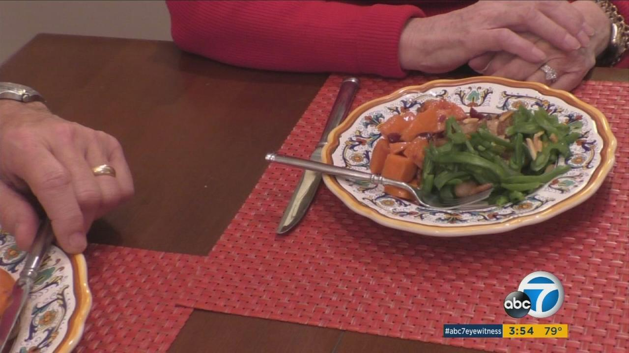 Food in a smaller portion is shown on a table with some clients from the no diet diet books author.