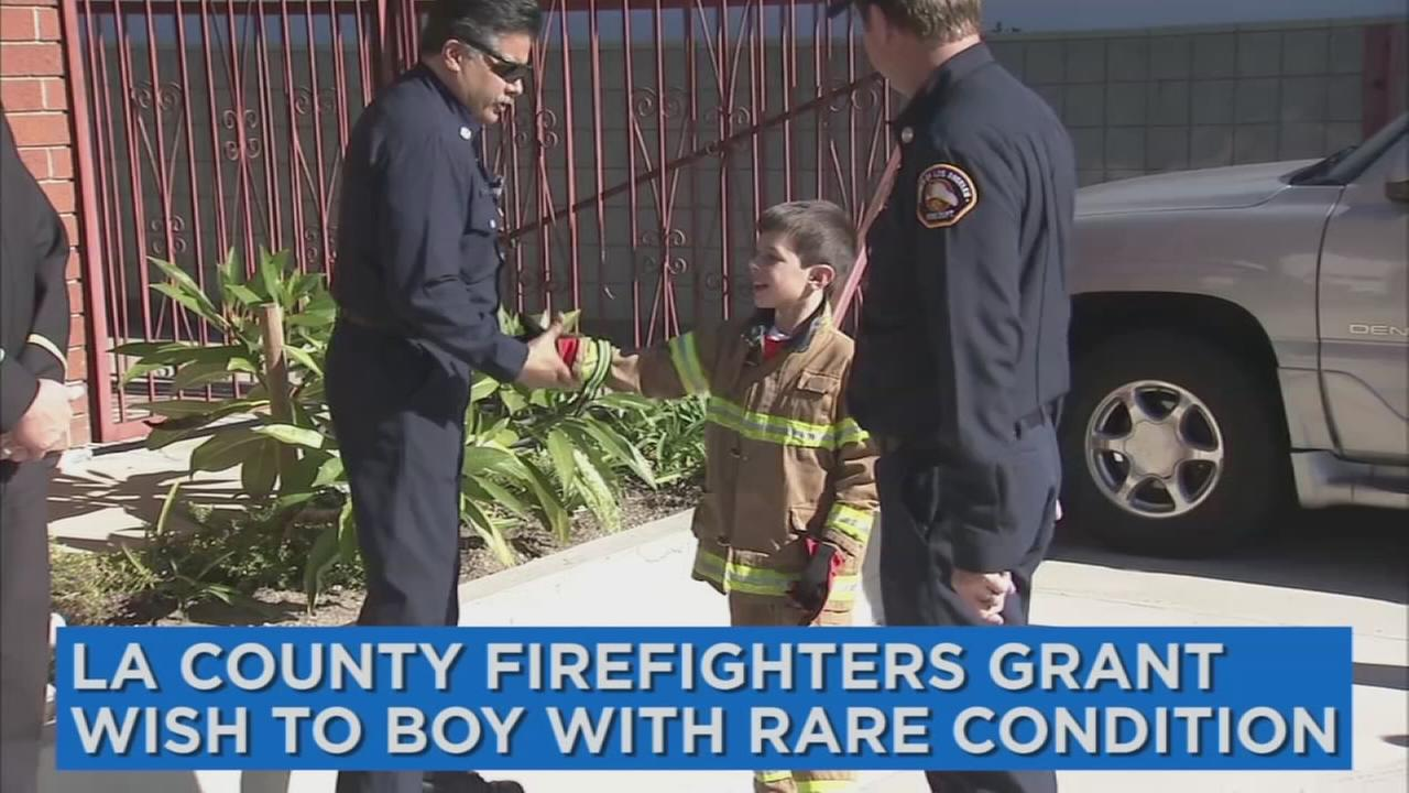 Calvin Grisham, an 8-year-old boy with a rare condition, had his wish to be a firefighter granted by the Los Angeles County Fire Department on Thursday, Dec. 29, 2016.