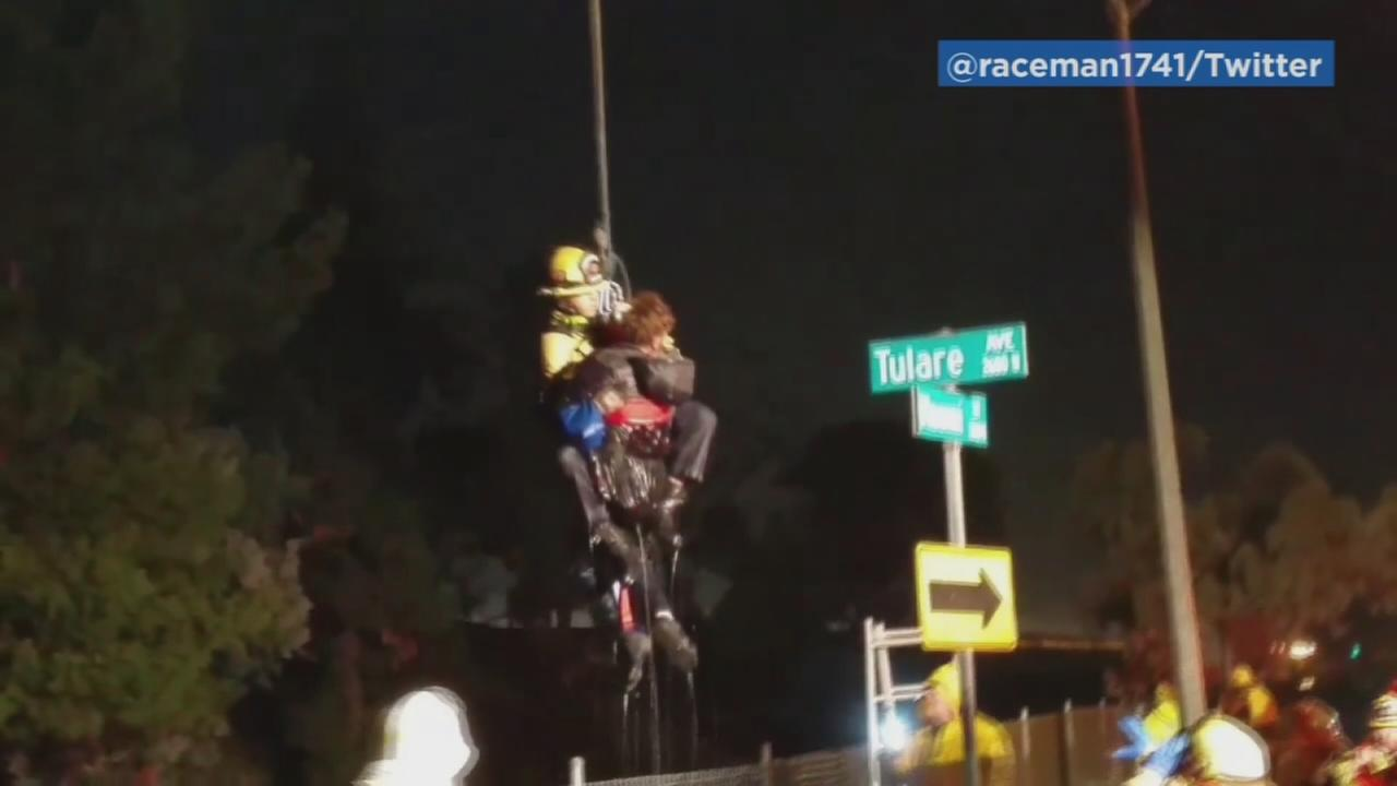 Video captured the dramatic rescue of a man from a wash in Burbank on Saturday, Dec. 31, 2016.