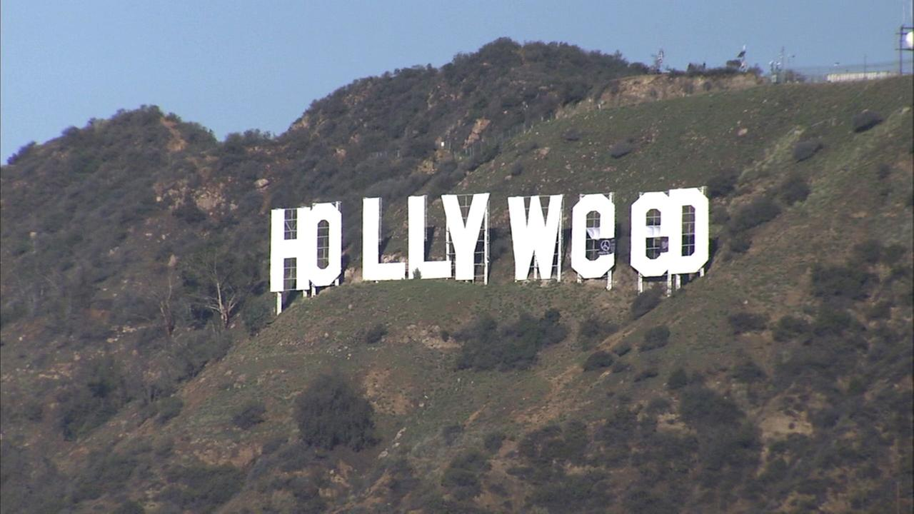 The altered Hollywood sign reads Hollyweed on Sunday, Jan. 1, 2017.