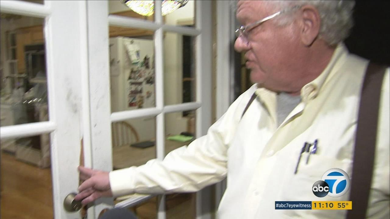 Caltech professor Thomas Heaton shows the door where an intrudor broke into his home in Pasadena on Thursday, Jan. 5, 2017.