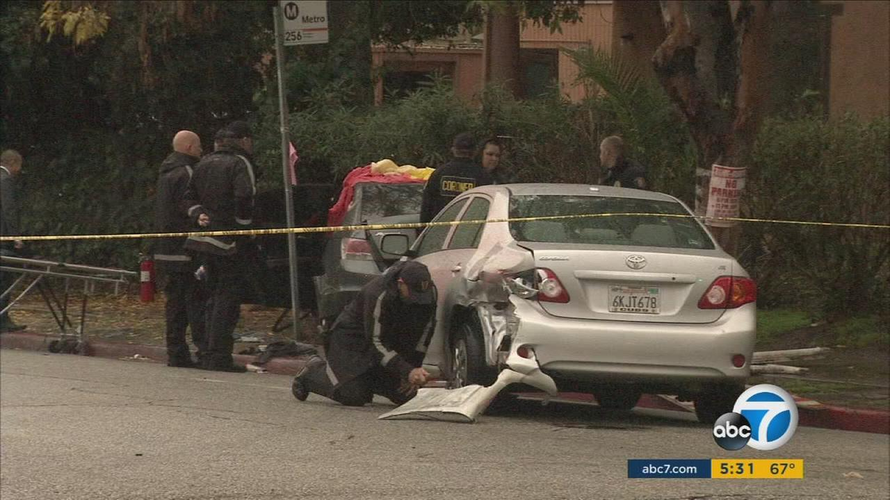 Authorities investigated the scene of a car crash and double-homicide in Pasadena on Saturday, Jan. 7, 2017.