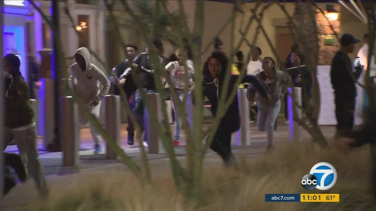 Dozens of teenagers ran from the Fox Hills Mall in Culver City as authorities came in to break up fights that erupted during reports of a gunman in the area on Jan. 7, 2017.