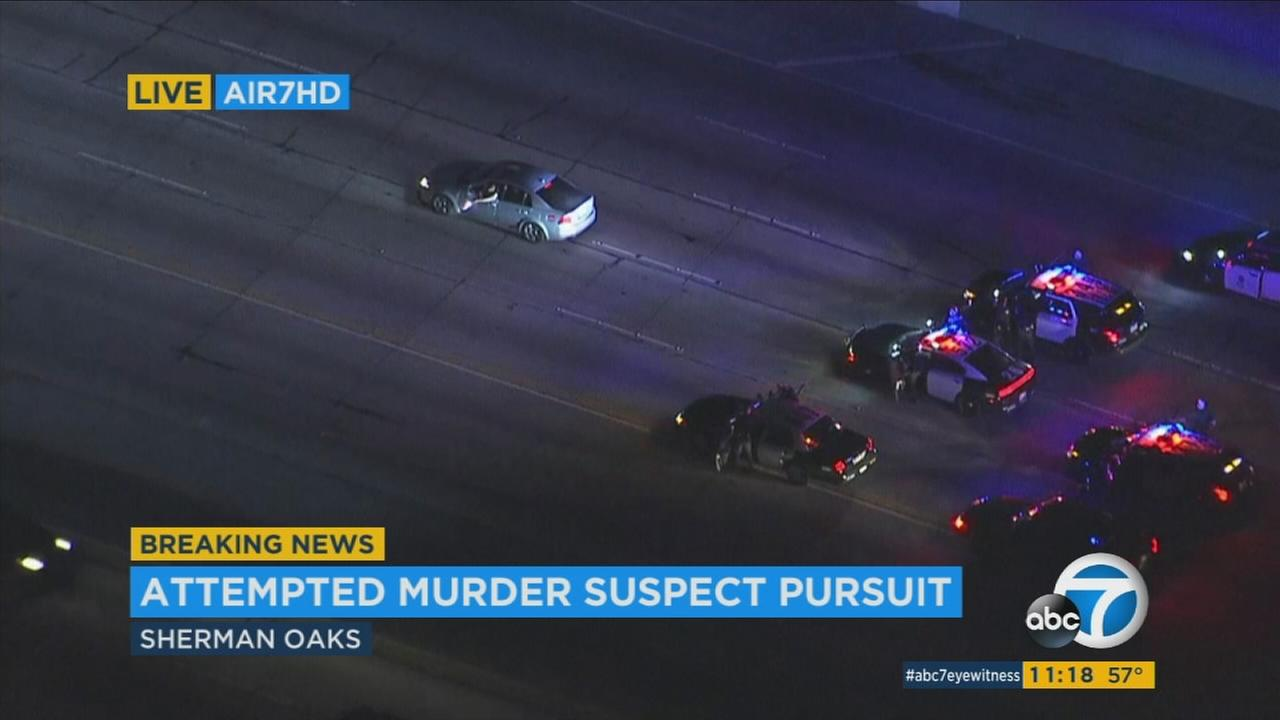 A suspect fired out his window as he led officers on an erratic chase on the 405 Freeway in the San Fernando Valley.
