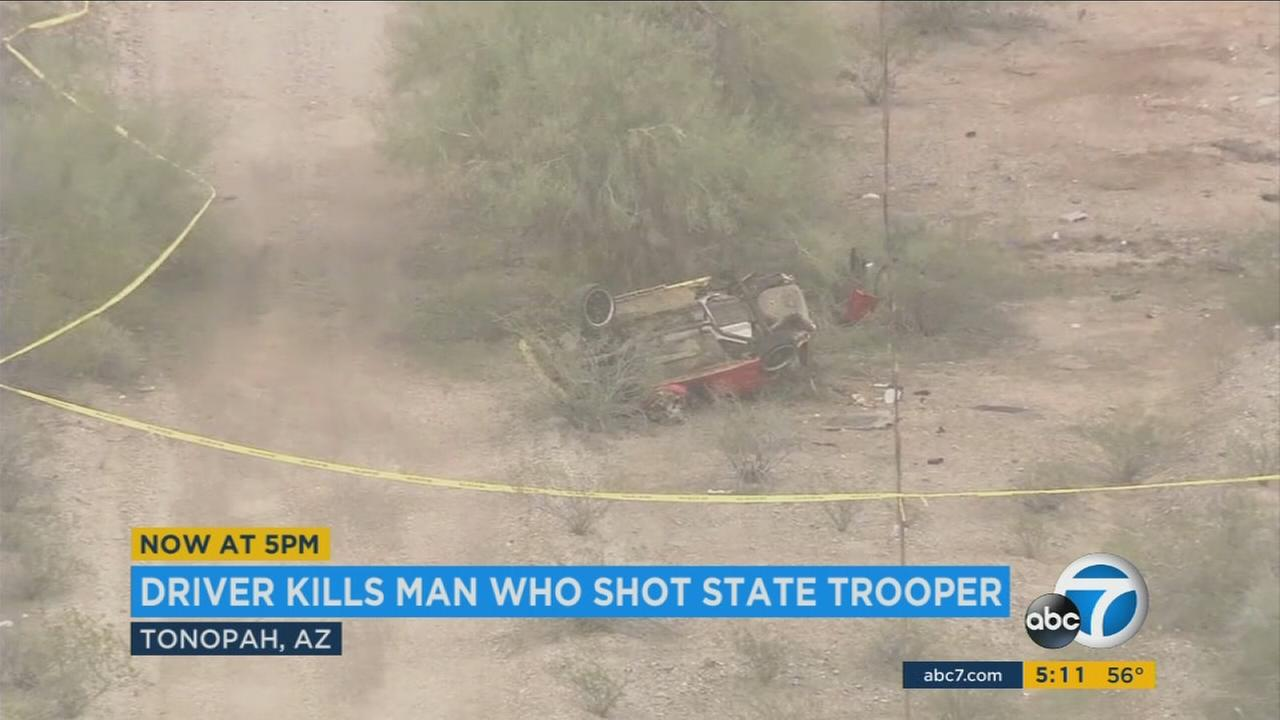 A crime scene shows the aftermath when an Arizona trooper was shot and a Good Samaritan stepped in to help.