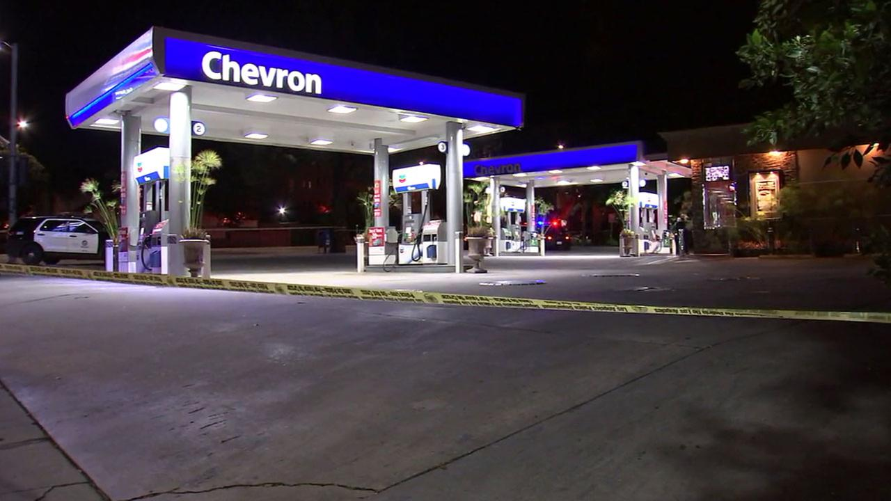 Authorities cordoned off a Chevron gas station in Los Feliz after a robbery suspect shot and killed a clerk inside on Tuedsday, Jan. 17, 2017.
