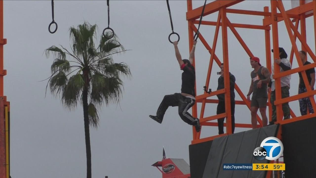 Tough Mudder participants are seen at Muscle Beach in Venice.