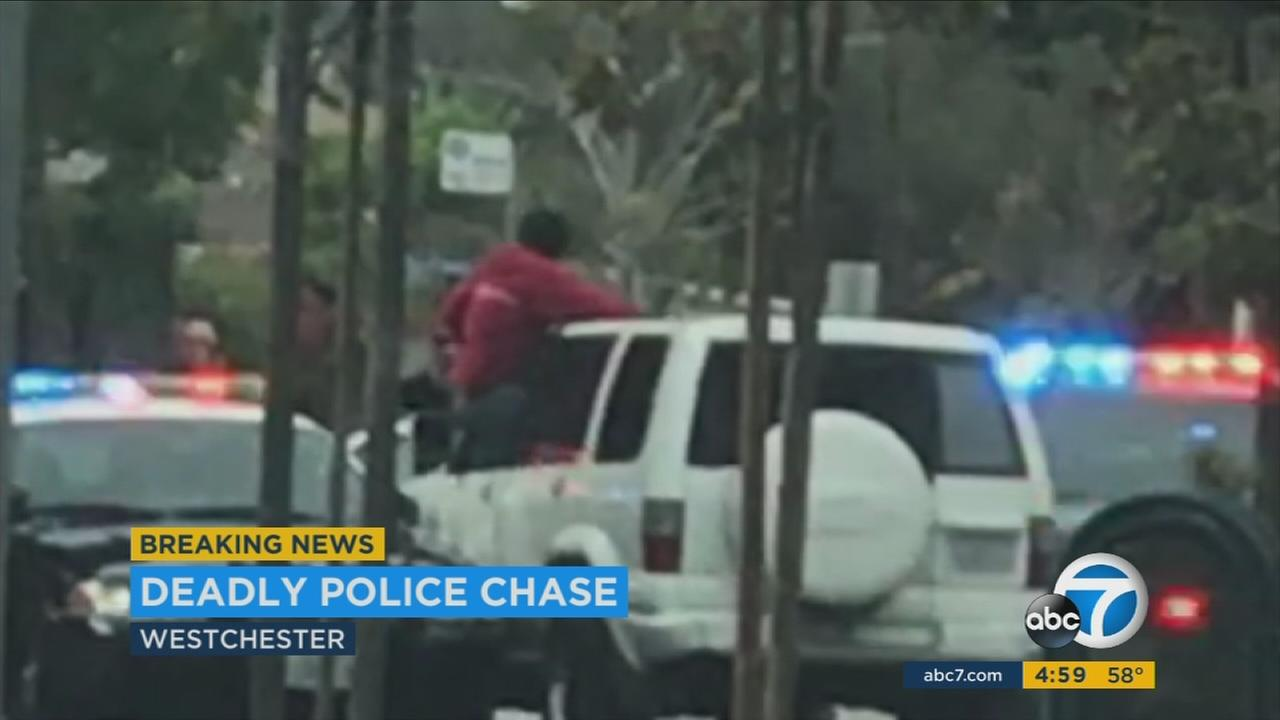 A man armed with a hatchet was shot by officers after a short chase ended in Westchester just north of Los Angeles International Airport on Wednesday, police said.