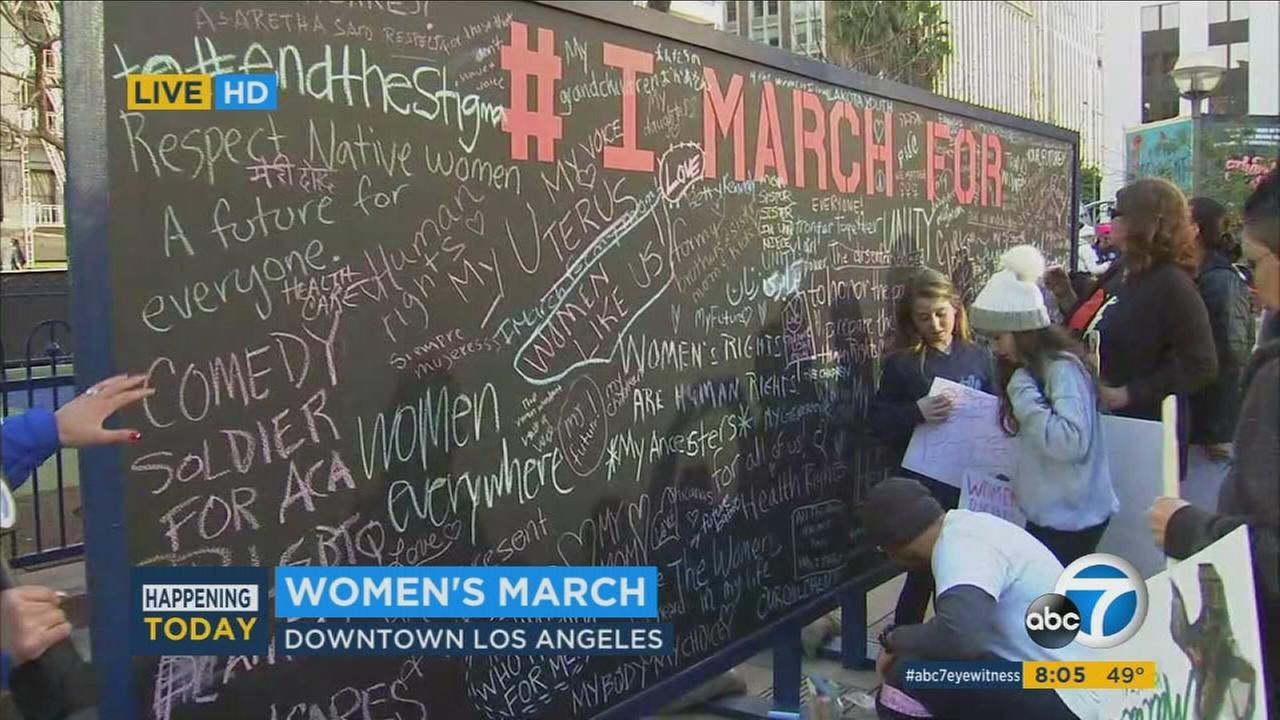 Activists at the Womens March-Los Angeles write down what they are marching for on Saturday, Jan. 21, 2017.