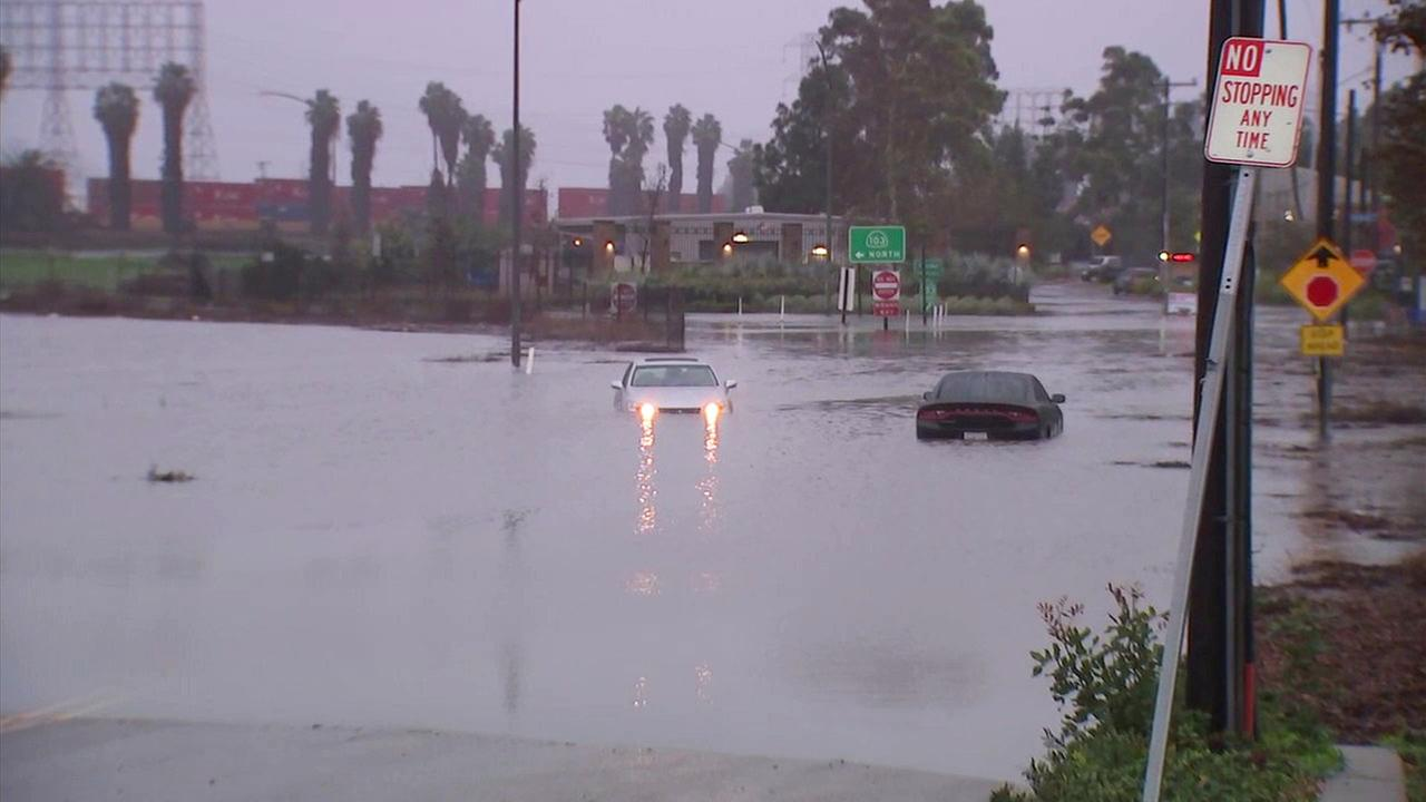 Cars are seen flooded in water in Long Beach during a heavy rainstorm in Southern California on Sunday, Jan. 22, 2017.