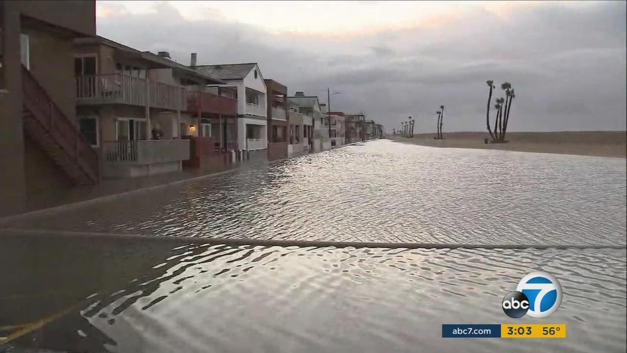 Flooding reaches dangerously close to oceanfront homes in Seal Beach on Sunday, Jan. 22, 2017.
